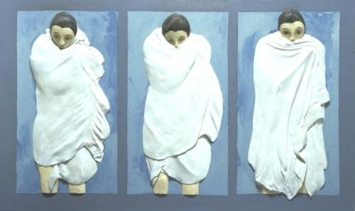Triptych: wrapped figures
