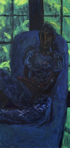 Woman Sitting In A Dark Room