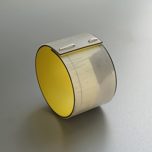Bangle with yellow inside.