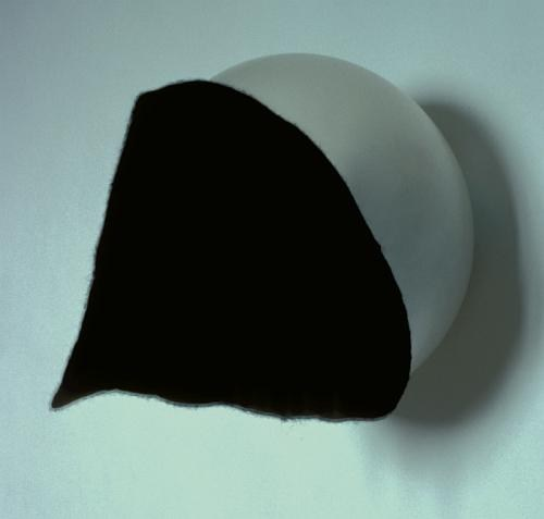 Untitled (wall mounted, with cream-coloured fabric, left), and Untitled (wall mounted, with black f - Credit: Pam Day