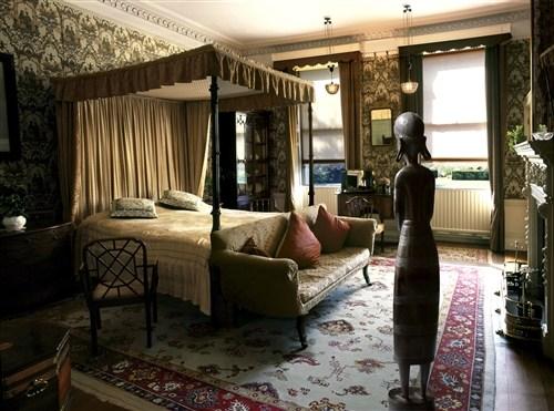 Bedroom with Wooden Figure
