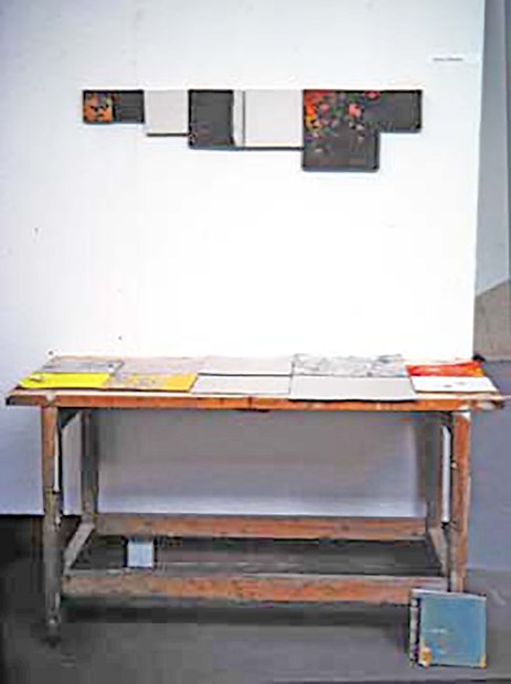 Seven squares on a wall, table and floor