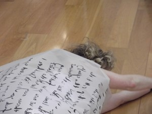 Vein - Spoken word, performance: Eleven metre scroll of transparent paper printed, by Angela Kennedy