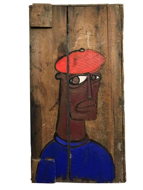 I am a black man in a red cap